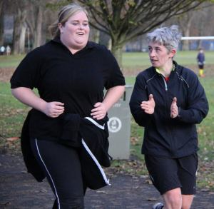 Gordon Donnachie's photo from Perth parkrun's inaugural, with a parkrunner supporting the final finisher home, whom herself was showing awesome determination to finish!