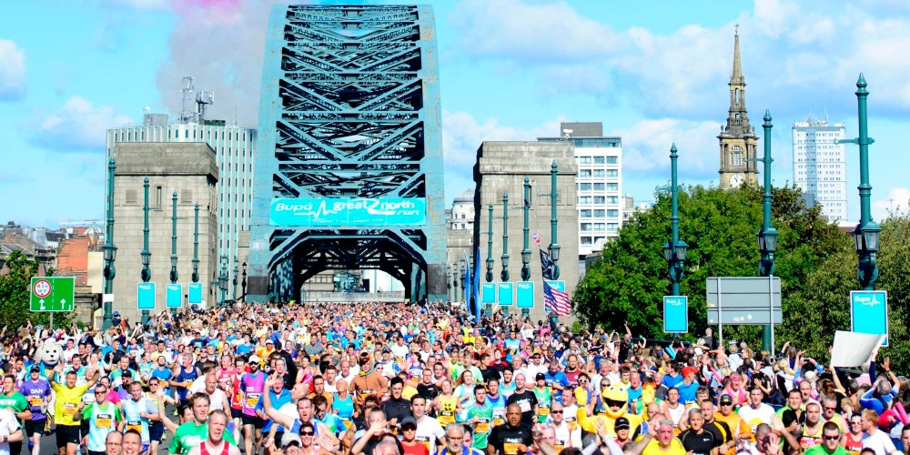 The Red Arrows fly over the Tyne Bridge during 2014 Bupa Great North Run, Newcastle.